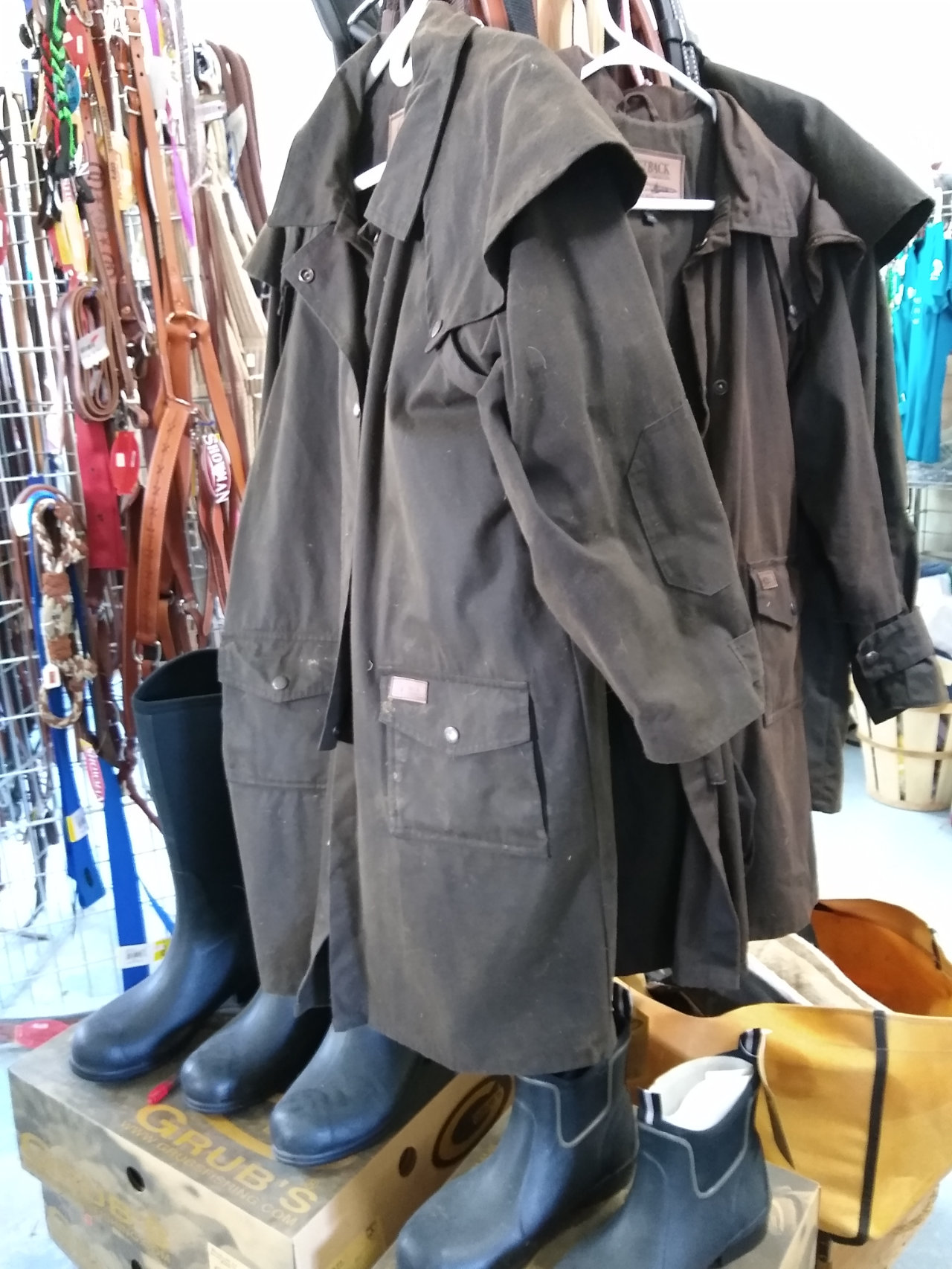 Outdoor clothing for riding horses, overcoat and boots